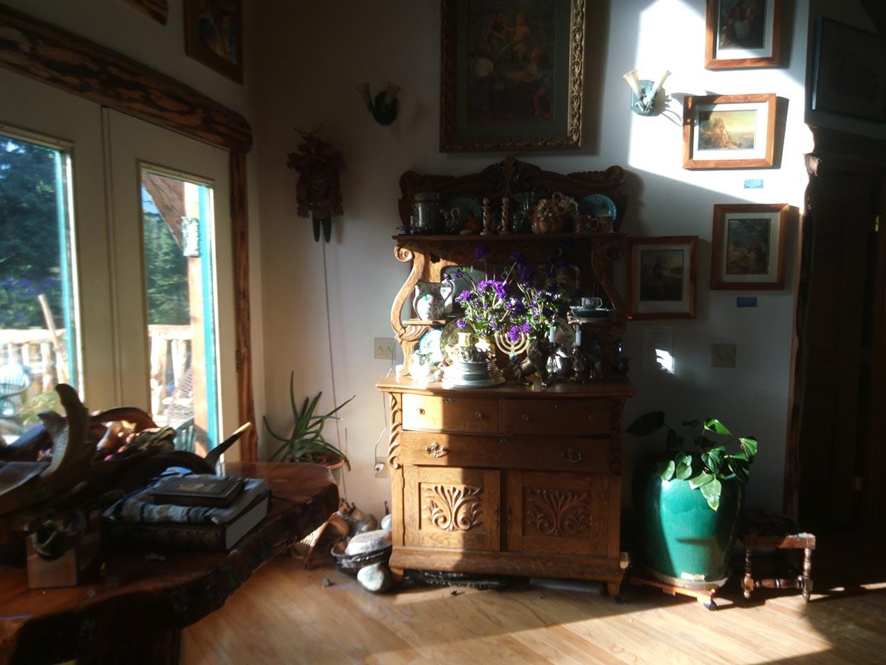 B&B interior - cabinet and framed photos.
