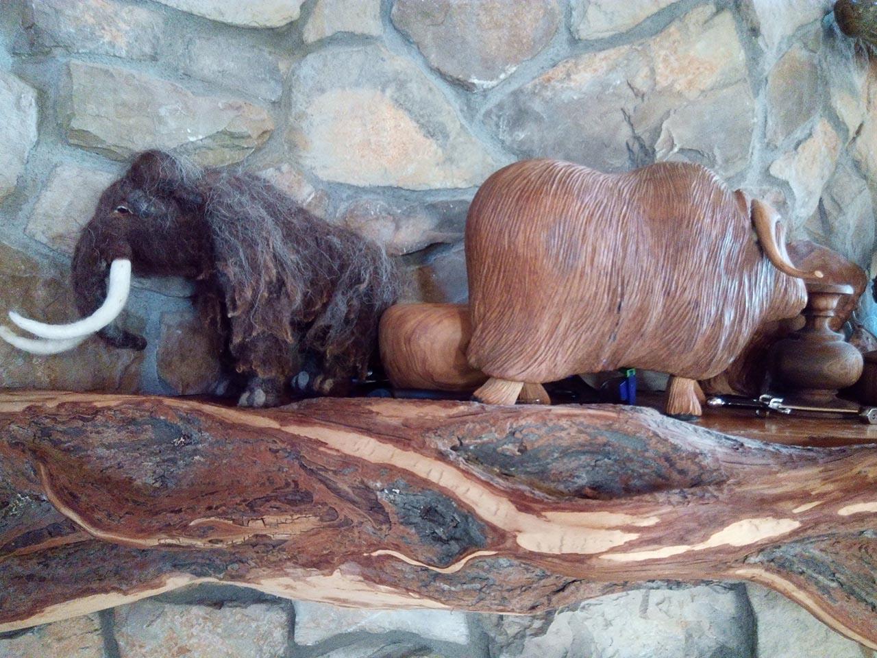 Mantle decorations - mini mammoth and yak.