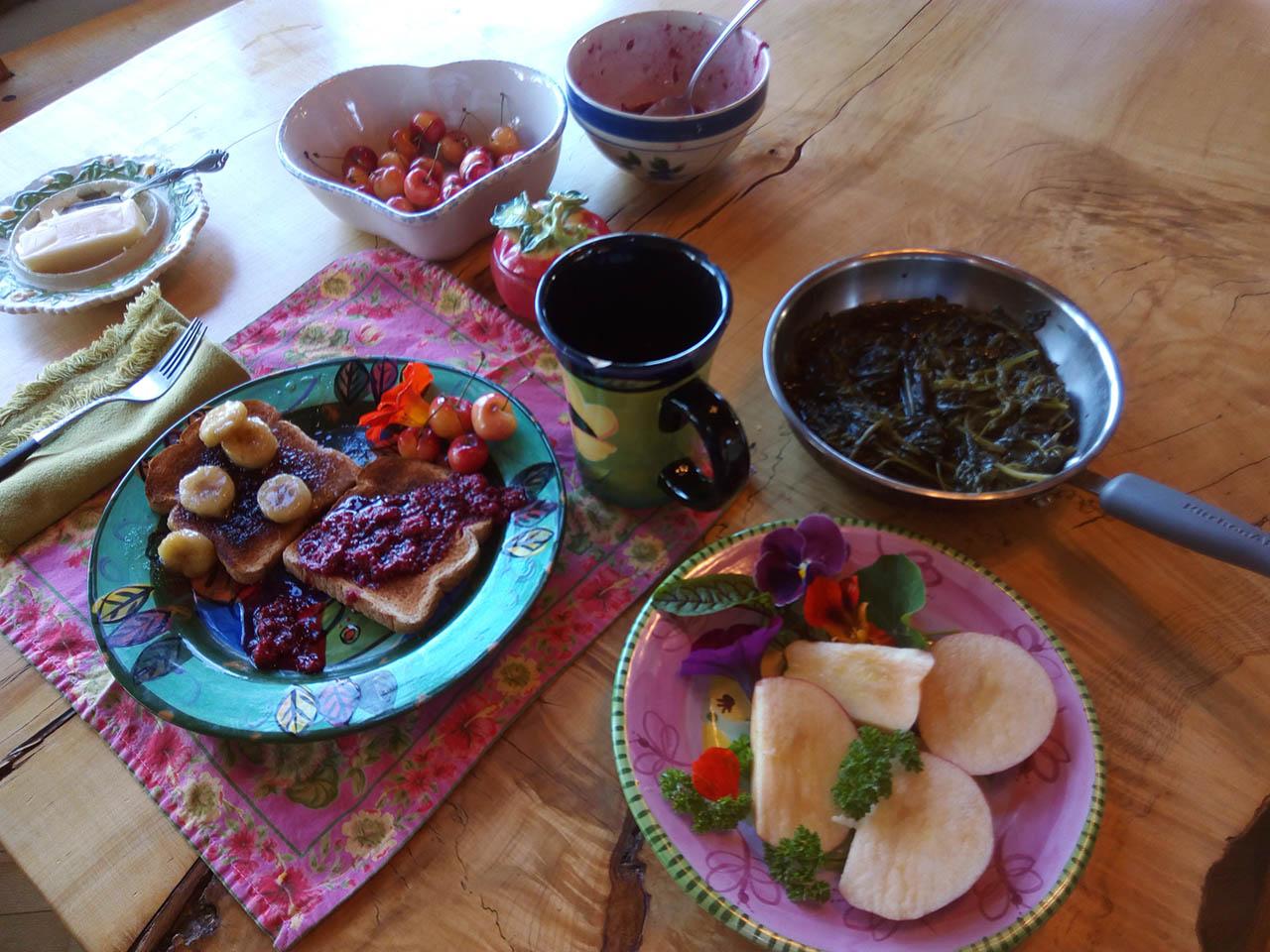 Breakfast jams, bread, fruit.