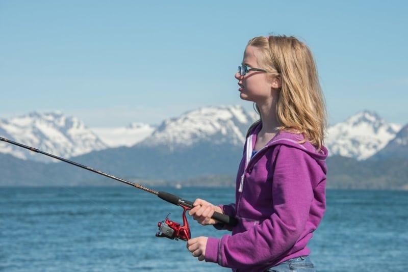 Young girl river fishing.